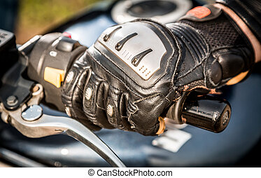 Motorcycle Racing Gloves - Human hand in a Motorcycle Racing...