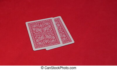 Human hand passing two cards in poker game. - Human hand...