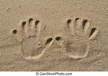 Human hand prints - Two human hand prints in the sand