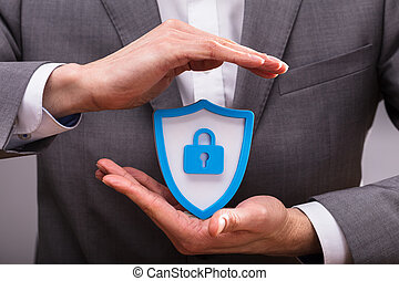 Human Hand Protecting Shield Security Icon