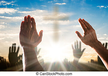 Human Hand Raising Hands With Cross In The Center