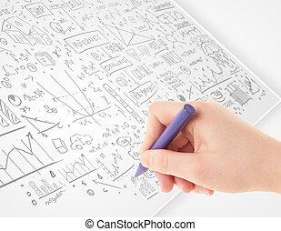 Human hand sketching ideas on a white paper