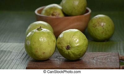 human hand take guava from cutting board