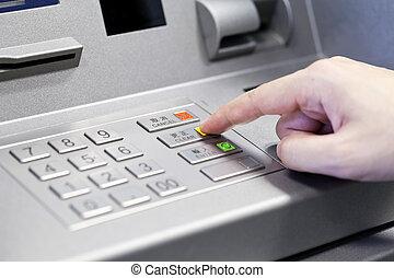 Human hand using ATM machine