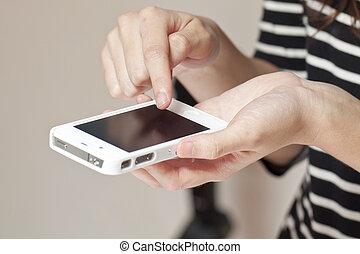 Human hand using smart phone