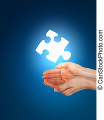 human hand with a piece of puzzle