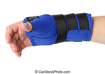 Human hand with a wrist brace, orthopedic equipment over...