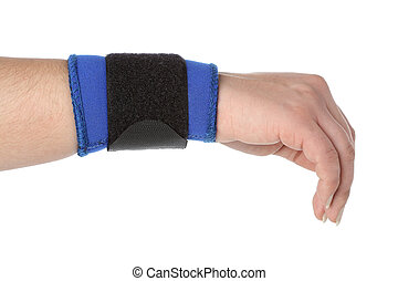 Human hand with a wrist brace, orthopedic equipment over...