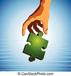 human hand with green shining piece