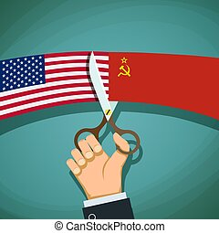 Human hand with scissors cuts the USA flag and the USSR. Cold Wa