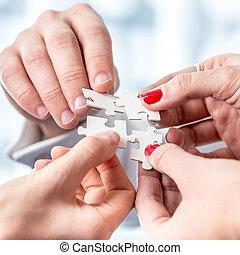 Human Hands Assembling Puzzle Pieces