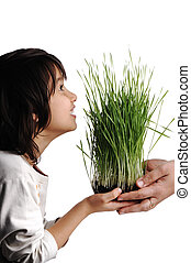 Human hands, floral giving isolated, grass concept