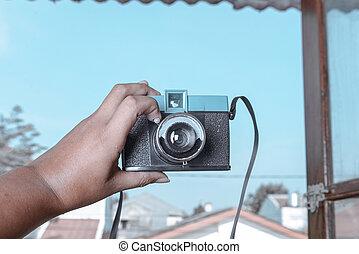 Human hands holding a camera
