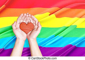 Human hands holding heart