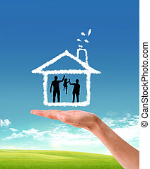 human hands holding model of a house   nature background