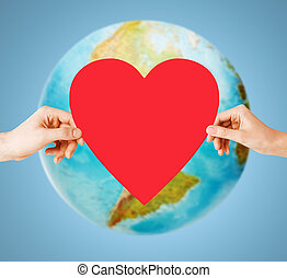 human hands holding red heart over earth globe - people, ...