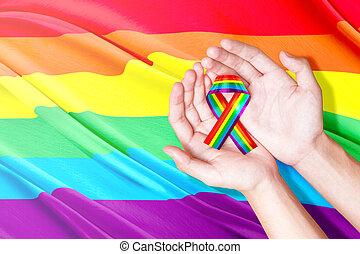 Human hands holding ribbon