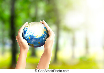 Human hands holding the earth