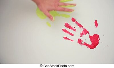 Human Hands Leave Imprints In The Paint On The Wall.