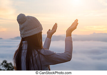 Human hands open palm up worship, Concept for Christian, Christianity, Catholic religion, divine, heavenly, celestial or god.