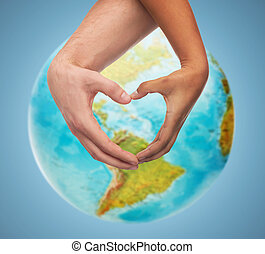 human hands showing heart shape over earth globe - people, ...