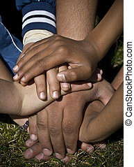 Closeup of human hands showing unity, mixed races