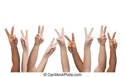 human hands showing v-sign