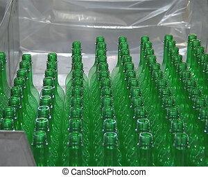 Human hands take green PET bottles.