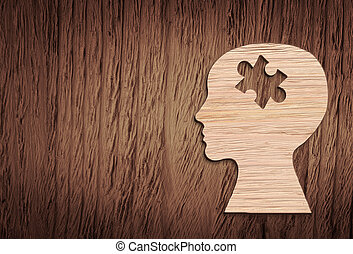 Human head silhouette with a jigsaw piece cut out