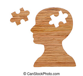 Human head silhouette with a jigsaw piece cut out. Puzzle.