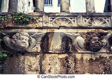 Human heads decorates a wall in Sibenik, Croatia