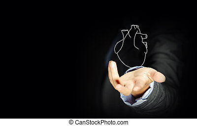 Human heart - Close up of businessman holding human heart in...