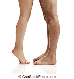 Human Legs - Man and woman legs isolated on a white...