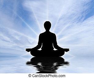 Human meditating - Human silhouette meditating over sky...