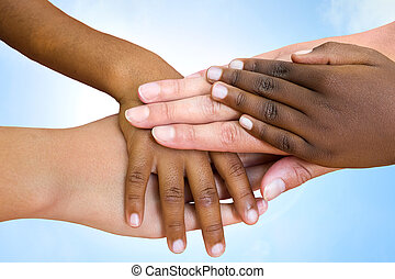 Human races joining hands. - Close up of multiethnic...