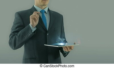 Human resources management concept business man selecting virtual interface pointing on glass icons hologram from tablet pad