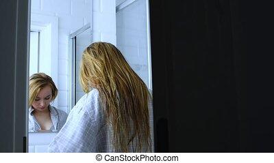 Peeking undressing woman in bathroom. Privacy politics.