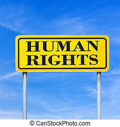 Human rights written on yellow road sign over blue sky.