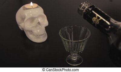 human scull and poison into a glass, macro