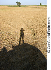 Human shadow on crop.