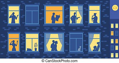 Human silhouettes in the evening windows