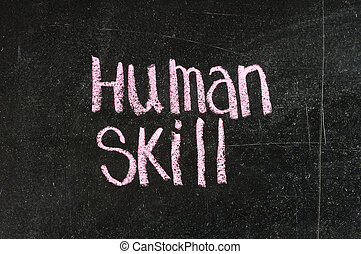 Human Skill handwritten with white chalk on a blackboard