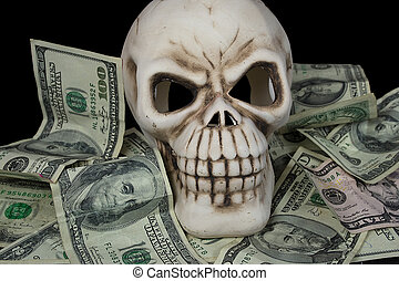 human skull in paper money - human skull head in a pile of...