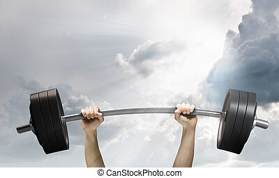 Human strength - Lifting barbell above head. Strength and...
