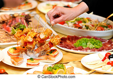 Human taking food on the party - Candid shot of human taking...