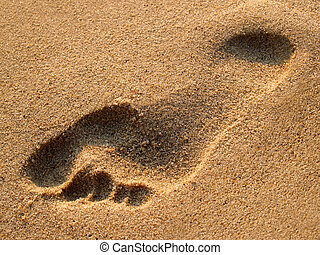 Human trace on sand - trace of a foot of the person on sea ...