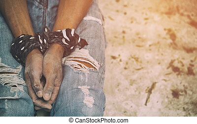 human trafficking, hands tied together with rope