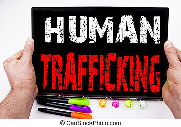 Human Trafficking text written on tablet, computer in the office with marker, pen, stationery. Business concept for Slavery Crime Prevention white background with copy space