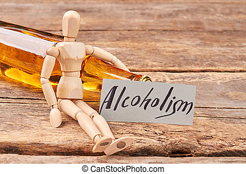 Human wooden dummy and alcohol.