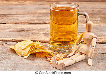 Human wooden dummy and beer.